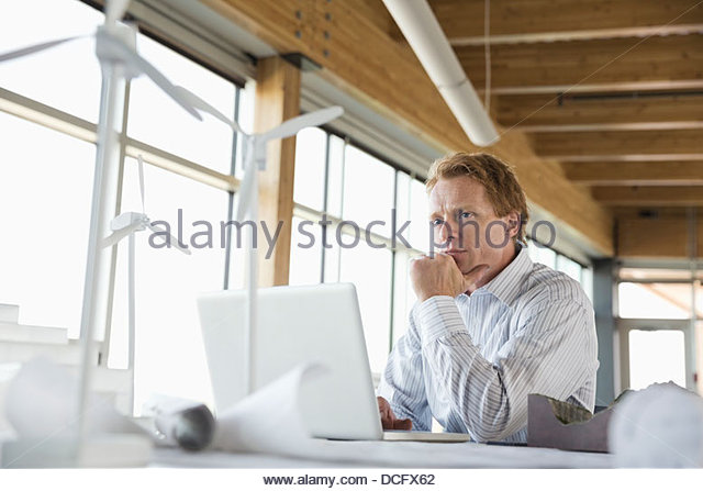 Sustainable energy engineer concentrating - Stock Image