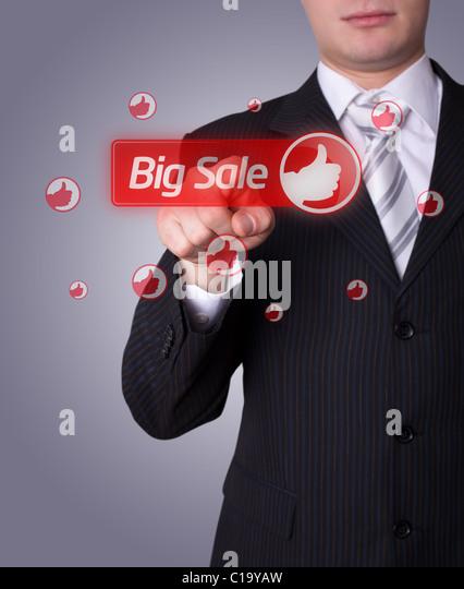 Man hand pressing BIG SALE button - Stock Image