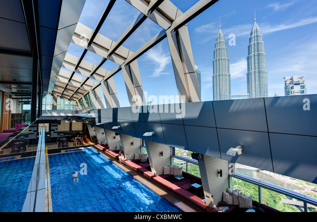 View from a rooftop pool and skybar of the iconic 88 Petronas Towers, Kuala Lumpur, Malaysia, Southeast Asia, Asia - Stock Image
