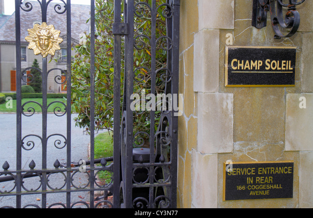Rhode Island Newport Bellevue Avenue Champ Soleil built 1929 French Norman chateau front gate - Stock Image