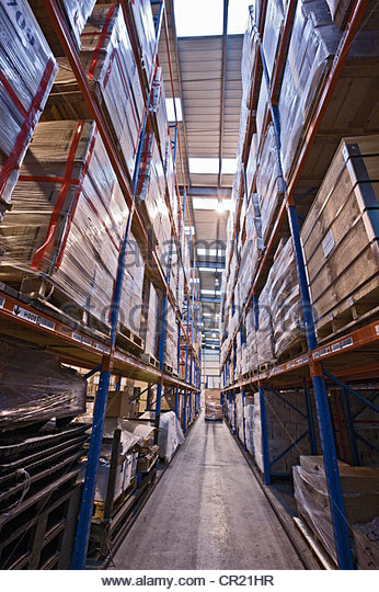 Stacks of pallets in warehouse - Stock Image