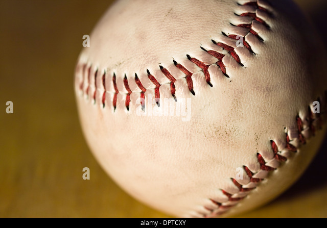 Close up of red stitching on a baseball - Stock Image