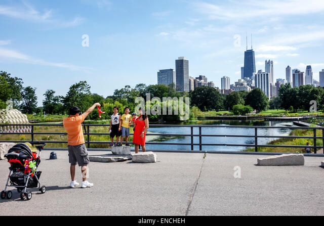 Chicago Illinois North Side Lincoln Park Lincoln Park Zoo public park Nature Boardwalk wildlife marsh habitat skyline - Stock Image