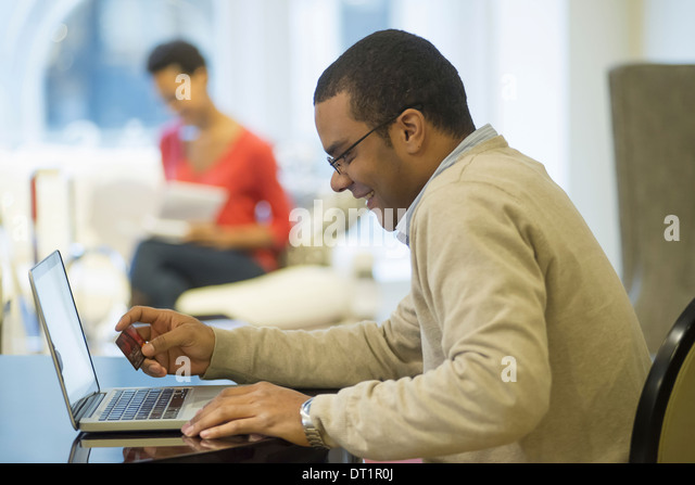 Man working in design store - Stock Image