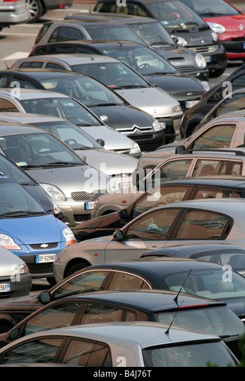 Parked cars in a congested parking lot - Stock Image