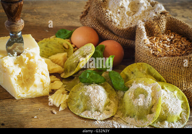Dumplings / ravioli with cheese, basil and pine nuts, pesto. Pasta with integral flour. - Stock Image