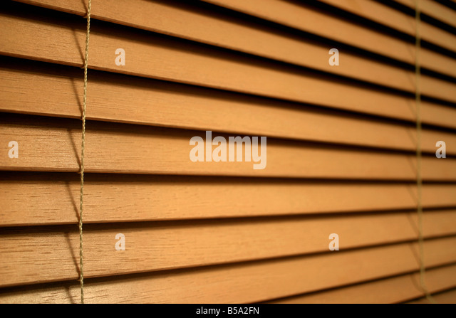 Closeup detail of wooden slat blinds - Stock Image