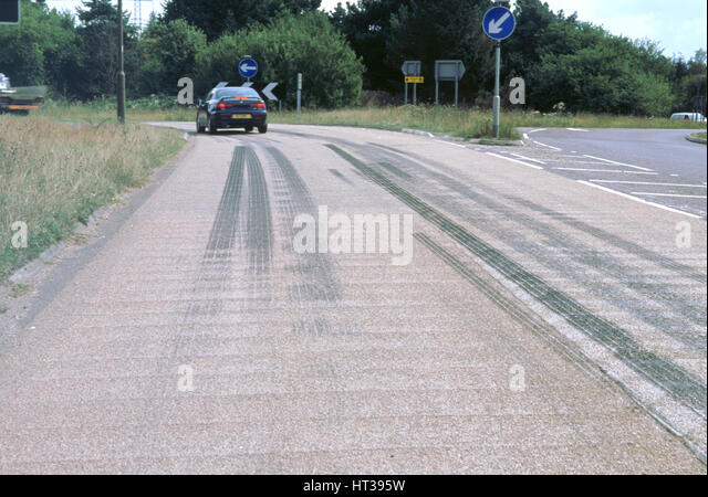 Tyre skidmarks on road surface. Artist: Unknown. - Stock Image