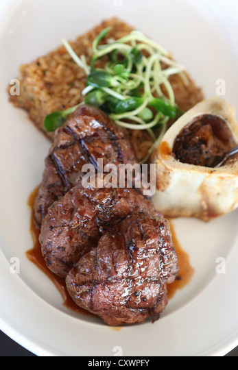 Plate of grilled beef with bone marrow - Stock Image