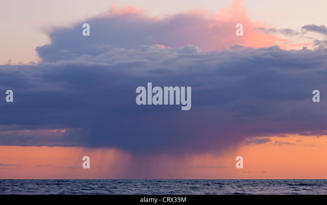 Heavy rainclouds at sunset over the English Channel, viewed from the Dorset Coast. Spring (April) 2012. - Stock Image