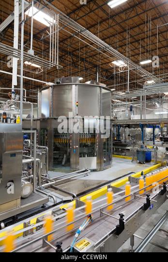 Bottles on production line at bottling plant - Stock Image