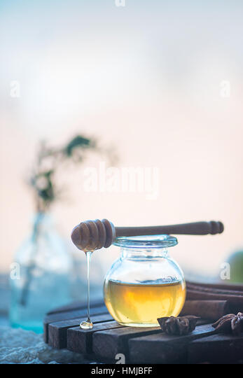 Organic honey in a glass jar - Stock Image