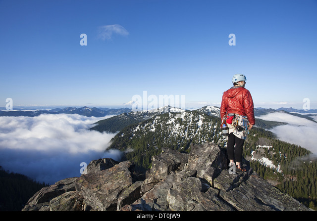 Washington state USA rock climber peak climbing to the top with rope - Stock Image