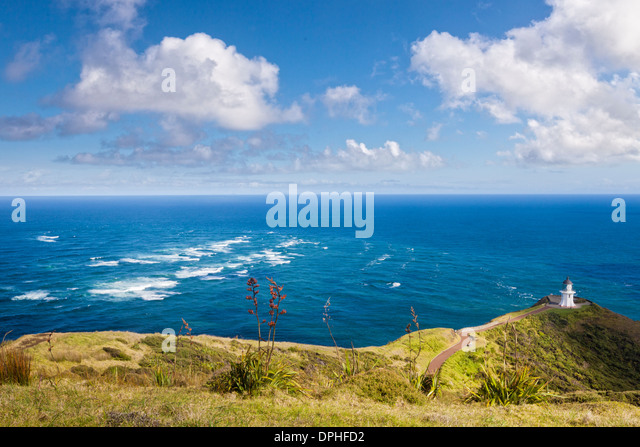 The famous lighthouse at Cape Reinga, Northland, New Zealand. The area of rough water is... - Stock Image