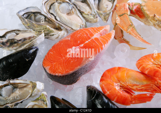 Atlantic salmon cutlet with crab, prawns and mussels - Stock Image