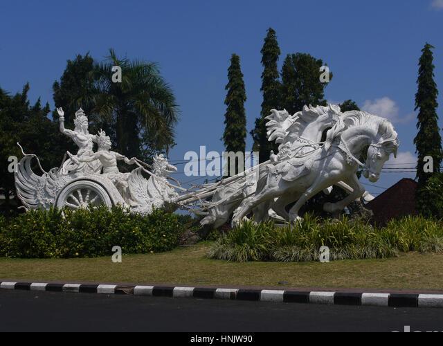 Arjuna and Krishna hindu gods riding chariot statue in Bali, Indonesia - Stock Image