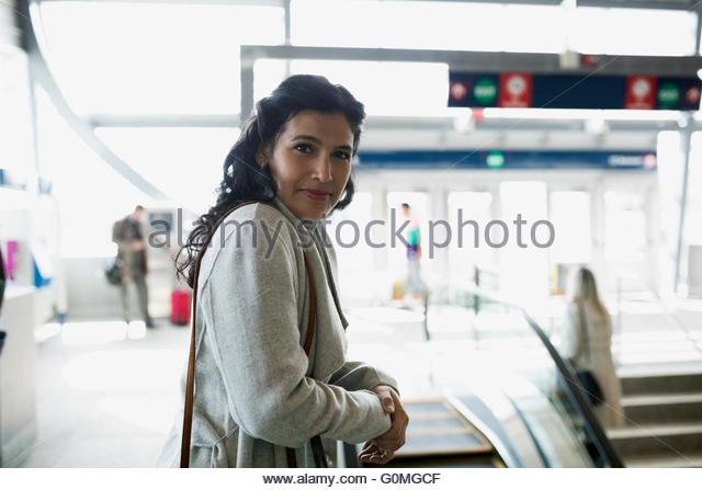 Portrait confident woman at train station - Stock Image