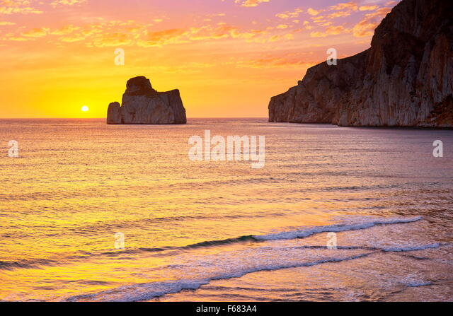 Pan di Zucchero at sunset time, Masua Village, Sardinia Island, Italy - Stock-Bilder