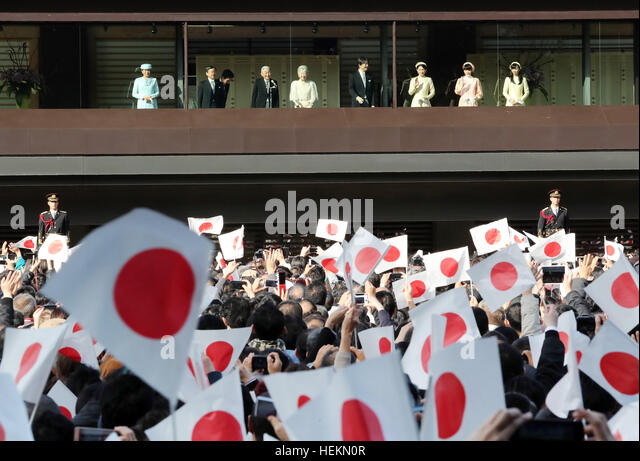 Tokyo, Japan. 23rd Dec, 2016. Wellwishers wave Japanese national flags as Japanese Emperor Akihito (3rd L) and members - Stock Image