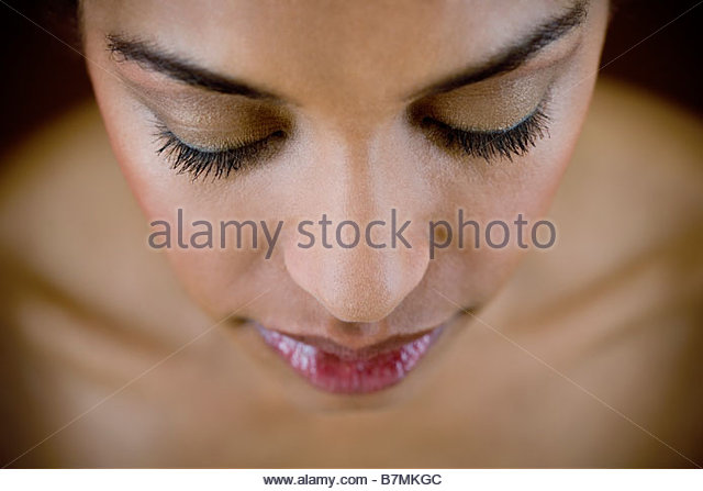 A portrait of a young woman, looking down - Stock Image