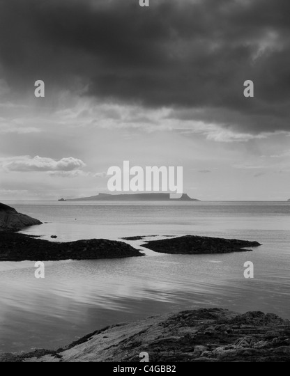 Stormy sky in a view of the Isle of Eigg from the Knoydart peninsula in Scotland - Stock Image