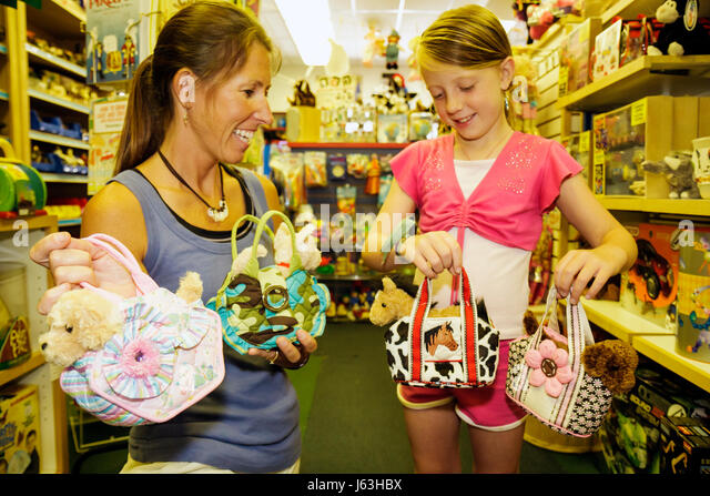 Michigan Traverse City Front Street Toy Harbor shopping family woman girl mother daughter merchandise play choose - Stock Image
