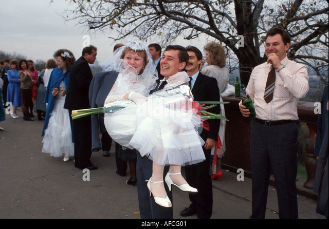 Russia former Soviet Union Moscow post wedding celebration groom bride - Stock Image