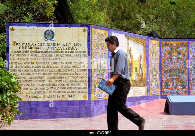 Argentina Mendoza Plaza Espana Spanish Fraternity Monument Majolica tile mosaic Hispanic man vegetation walking - Stock Image