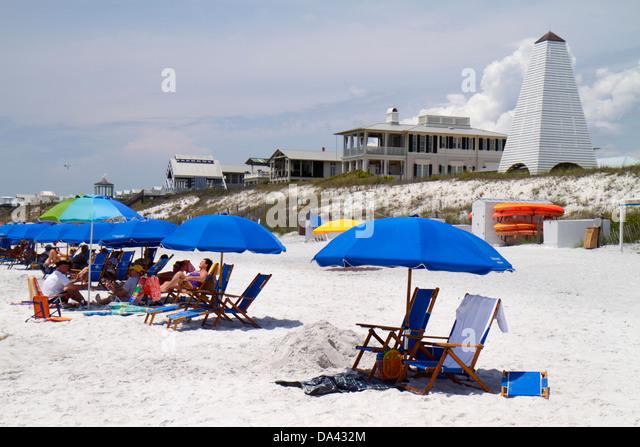 Florida Seaside master-planned community New Urbanism beach Gulf of Mexico coast sunbathers umbrellas white sand - Stock Image