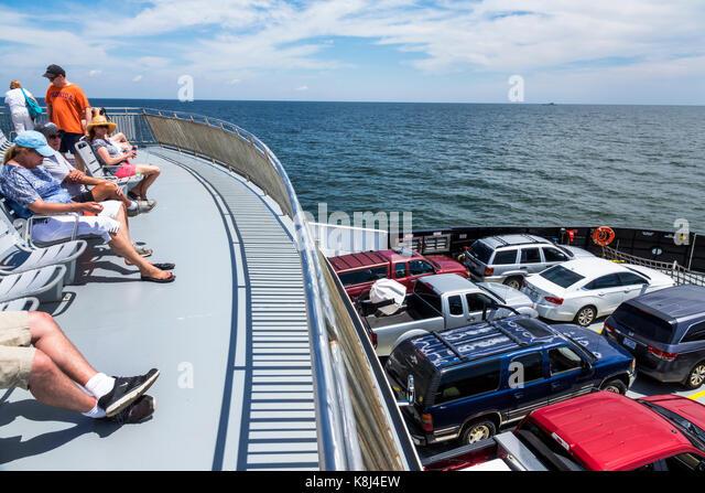 North Carolina NC Pamlico Sound Outer Banks Cedar Island Ocracoke ferry boat water vehicles passengers - Stock Image