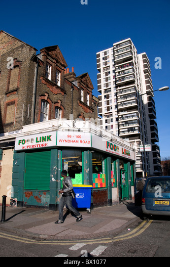 High-rise council flats  behind traditional buildings in South London - Stock Image