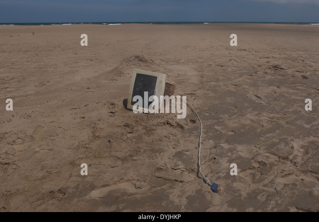electronic computer trash on beach - Stock Image