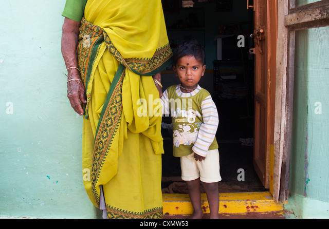Indian grandmother and baby boy in a rural indian village - Stock Image