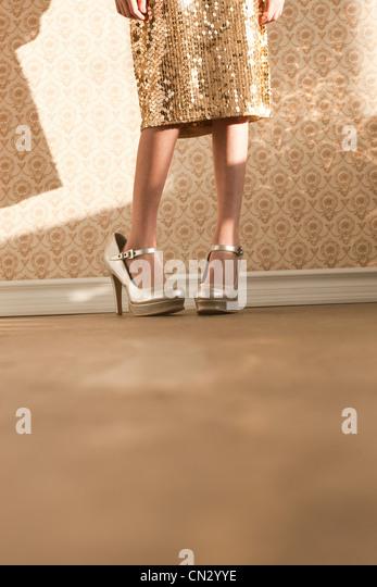 Girl wearing her mother's high heels - Stock Image