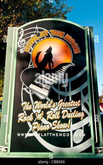 Howl at the Moon dueling piano bar sign on International Drive, Orlando Florida - Stock Image