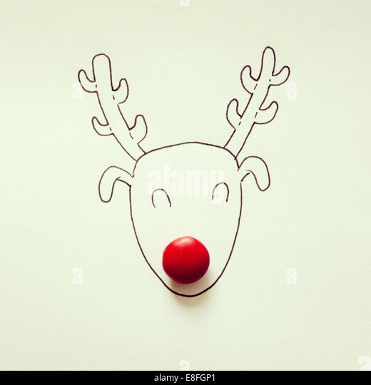 Rudolph the red-nosed reindeer illustration with red candy - Stock Image