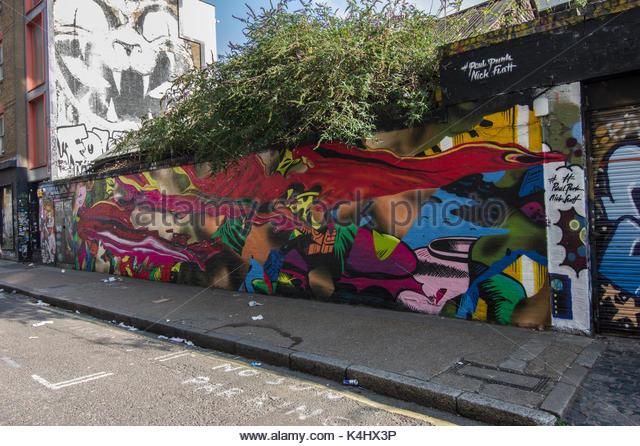 Vivid brightly coloured street mural on Sclater Street near Brick Lane, London, UK in an urban setting - Stock Image