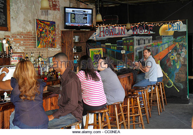 Louisiana New Orleans Warehouse District Howlin Wolf Den bar lounge live music venue business barstool Black man - Stock Image