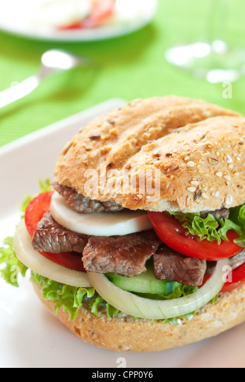 Fresh and healthy sandwich with vegetables and beef sliced - Stock Image