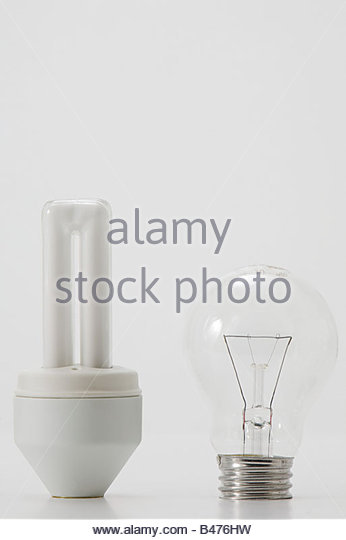 An ordinary and energy saving lightbulb - Stock Image