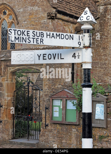 Old South Somerset CC finger post road sign Yeovil Ilminster Stoke Sub Hamdon, in centre of Montecute - Stock Image