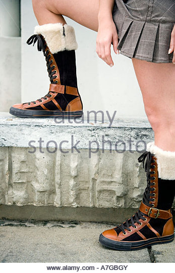A teenager wearing boots - Stock Image