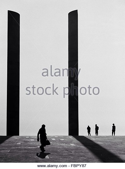 Silhouette People Walking Against Clear Sky - Stock Image