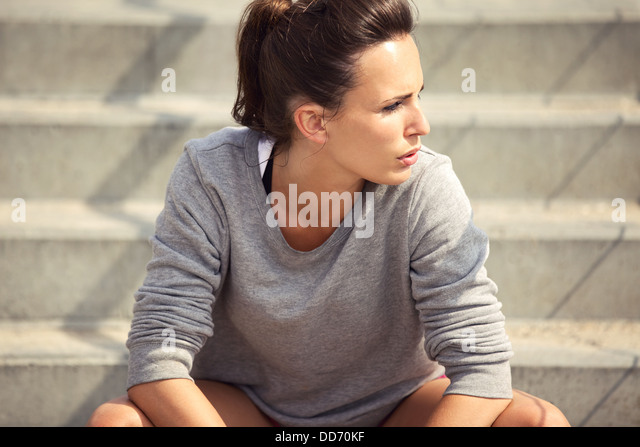 Closeup of an attractive female athlete resting after workout - Stock Image