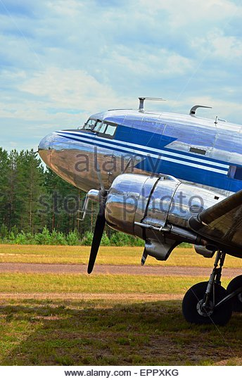 Old vintage airplane Douglas DC-3 Dakota on grass airfield - Stock Image