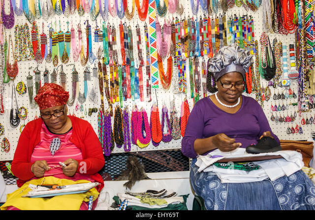 Johannesburg South Africa African Rosebank Mall The African Flea Market shopping sale display arts crafts vendor - Stock Image