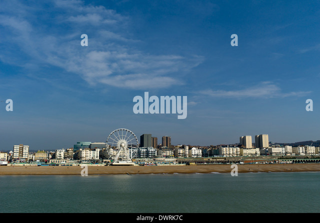 The seafront at Brighton, looking north east from the pier towards the wheel and the county hospital - Stock Image
