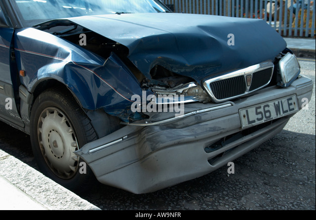 Crashed and Abandoned Car - Stock Image
