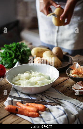Peeling potatoes - Stock Image