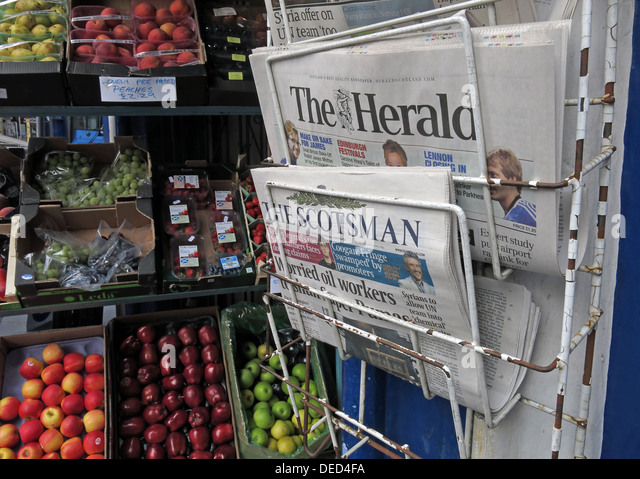 Local Newspapers on a stand Edinburgh Scotland at a grocers shop - Stock Image